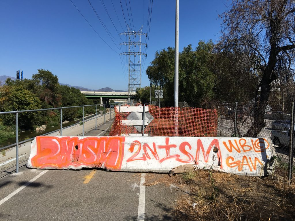 A cement barricade on the LA River Bike Path.